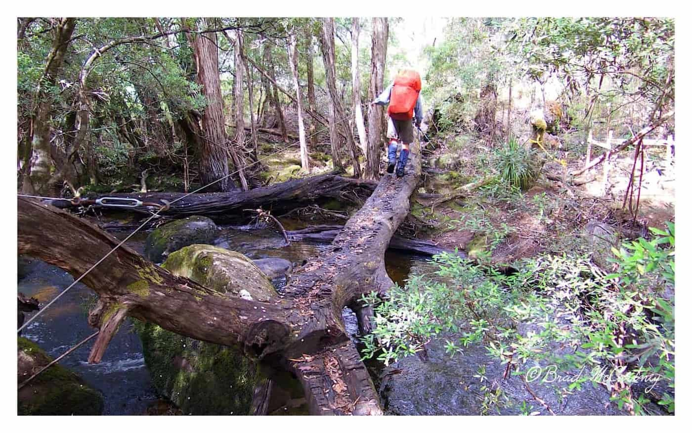 Doug crossing a river on route in the Pine Valley