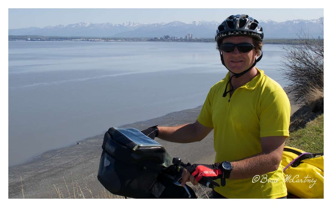 Start cycling Alaska, with downtown Anchorage in the background