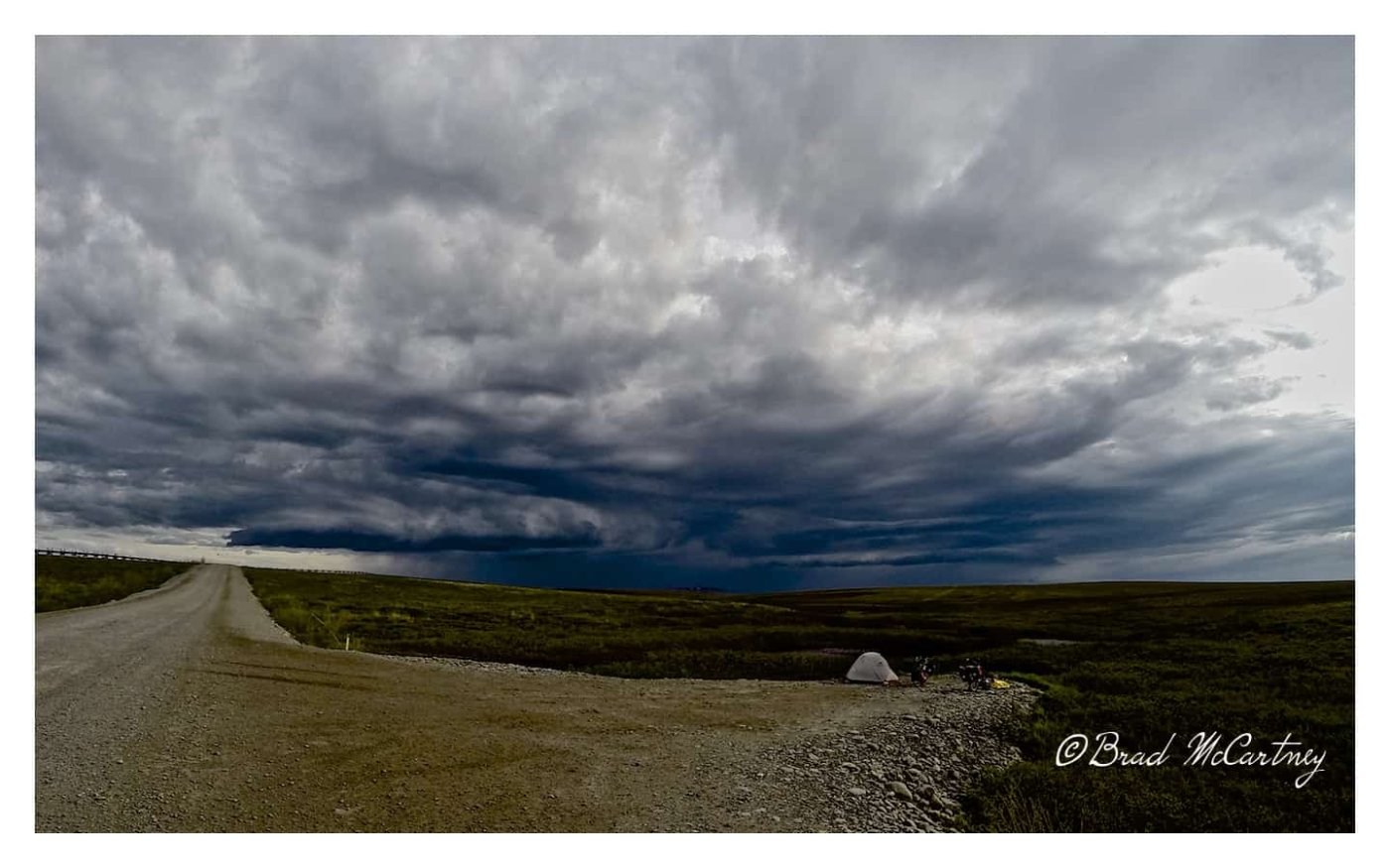 Waiting out the wind and storm before making a midnight cycle along the Dalton Hwy