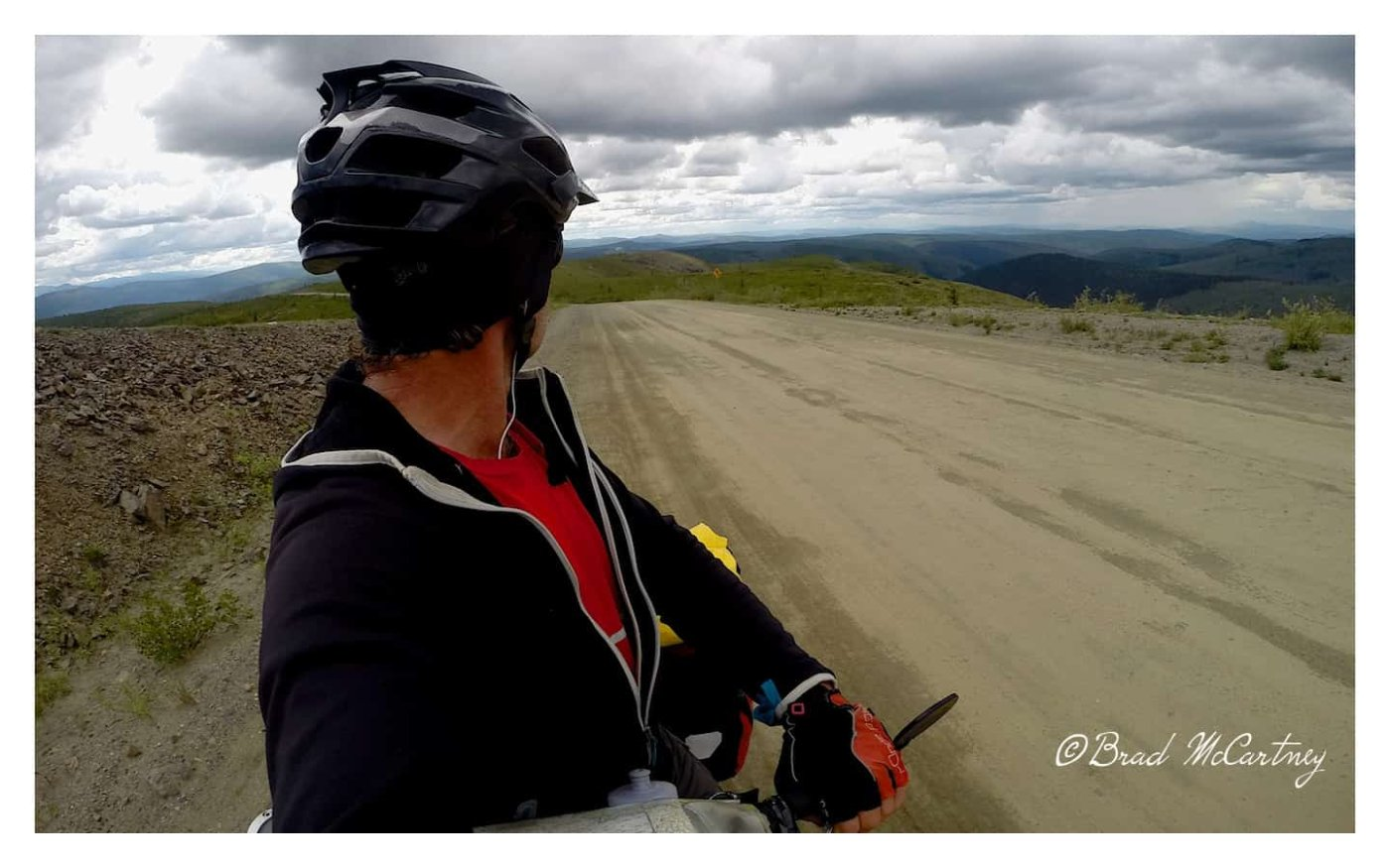 Rain clouds building all round me while cycling the top of the world highway
