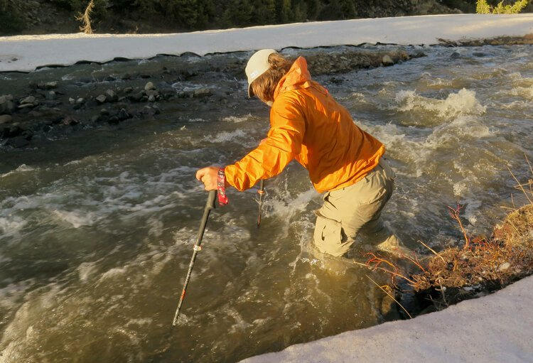 Best Trekking poles gear review crossing a river with hiking poles