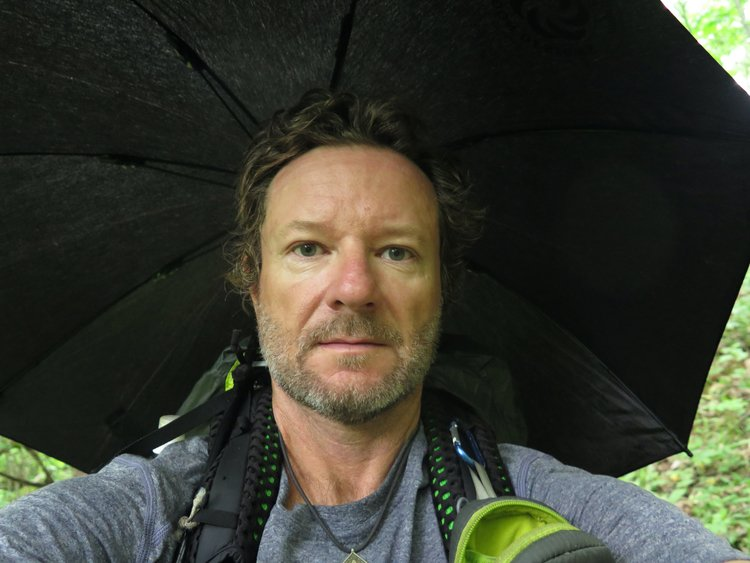 Lightweight Hiking Umbrella being used hands free while backpacking